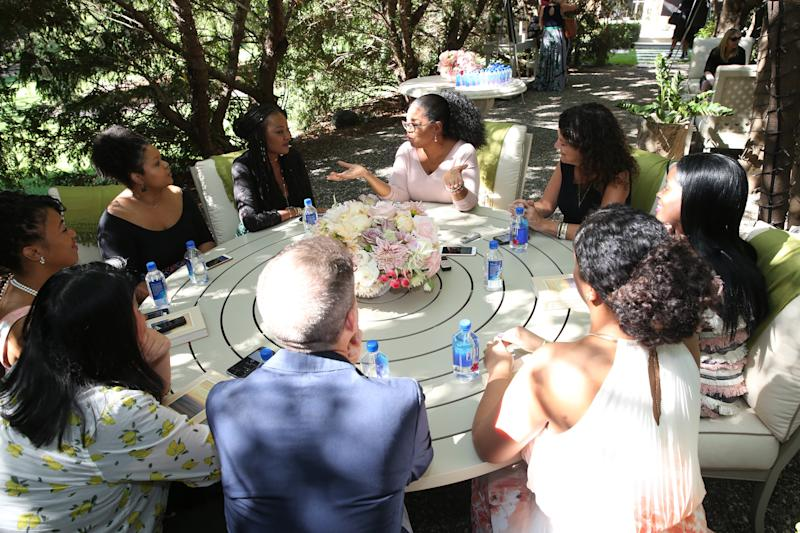 Oprah speaks to a roundtable of reporters during a special interview at her home in Santa Barbara, California. I'm pictured to her right. (Harpo Inc)