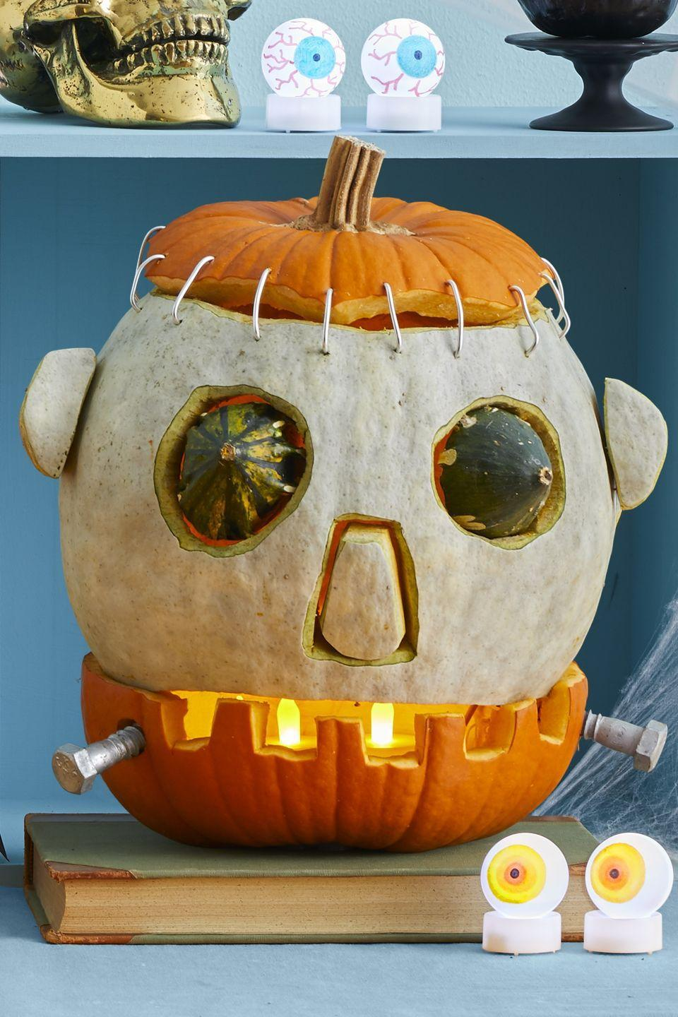 "<p>This is a mash-up of two medium-large pumpkins and two small gourds (for eyes). Once you've cut, carved, and stacked pieces, ""stitch"" Frank up by poking holes in the top parts and inserting 2"" pieces of wire.</p>"