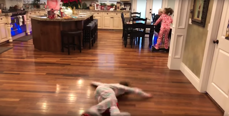 She completely stacks it onto the floor. Photo:YouTube/Kids Getting Hurt