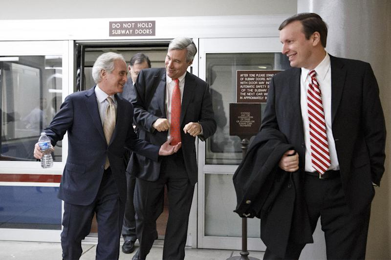 From left, Sen. Bob Corker, R-Tenn., Sen. Sheldon Whitehouse, D-R.I., and Sen. Chris Murphy, D-Conn., arrive for a procedural vote in the Senate on a bill that would extend unemployment benefits, at the Capitol in Washington, Monday, Jan. 6, 2014. Benefits expired for many long-term unemployed Americans on Dec. 28 after lawmakers did not extend the program as part of a bipartisan budget agreement. Sen. Jack Reed, D-R.I., is leading the effort to reauthorize the benefits for three months nationwide, but Republicans are balking however have balked at the proposed extension without offsets for the $6.5 billion that it will cost. (AP Photo/J. Scott Applewhite)