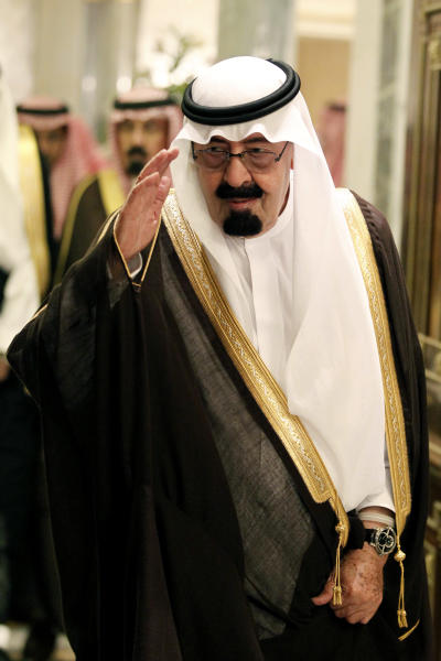 File - In this Tuesday, May 11, 2010 file photo, Saudi King Abdullah bin Abd al-Aziz, salutes as he arrives to the opening of the Gulf Cooperation Council (GCC) consultative summit in Riyadh, Saudi Arabia. Saudi Arabia, the United Arab Emirates and Bahrain said Wednesday, March 5, 2014 that they have recalled their ambassadors from the Gulf nation of Qatar over its alleged breach of a regional security deal in the clearest sign yet of the rift among Gulf Arab countries over Islamists in the region. Tensions have been brewing between Gulf countries and Qatar since Egyptians ousted President Hosni Mubarak and Qatar's massive financial and public support for his successor, Islamist President Mohammed Morsi, stood at odds with the UAE and Saudi Arabia's policies. (AP Photo/Hassan Ammar, File)