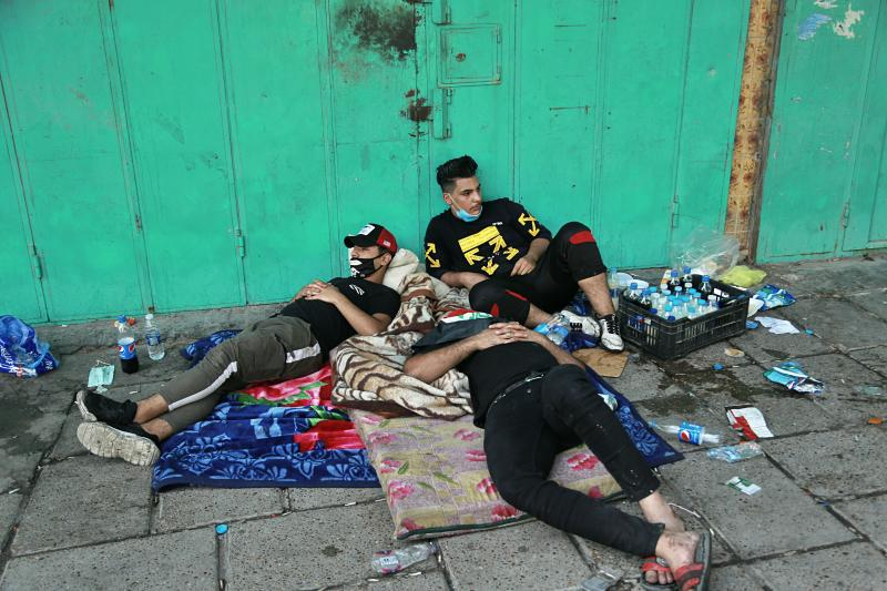Anti-government protesters rest during sit-in at Tahrir Square in Baghdad, Iraq, Saturday, Oct. 26, 2019.  The latest eruption of anti-government anger followed a nearly three-week hiatus to leaderless, spontaneous revolts which were violently quelled earlier this month in the war-torn country. (AP Photo/Hadi Mizban)
