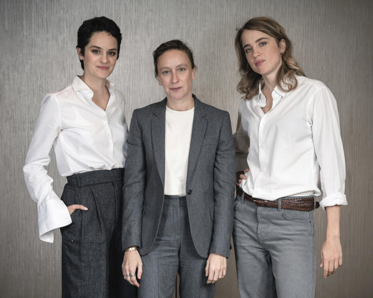 """FILE - This Sept. 30, 2019, file photo shows, from left, actress Noemie Merlant, filmmaker Celine Sciamma, and actress Adele Haenel posing for a portrait in New York to promote their film, """"Portrait of a Lady on Fire."""" The emotions stirred up by the film have been considerable since its debut at last May's Cannes Film Festival. There, it won best screenplay and Sciamma became the first female director to win the Queer Palme, an award given to the best LGBTQ-themed film across the festival. (Photo by Christopher Smith/Invision/AP, File)"""