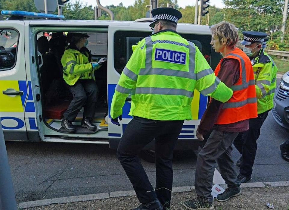 Officers lead a protester to a police van at a slip road at Junction 18 of the M25, near Rickmansworth (Steve Parsons/PA) (PA Wire)