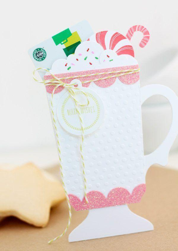 """<p>Say it with hot chocolate (and a gift card)! This adorable gift card holder is simple to make, and it's an easy way to elevate any <a href=""""https://www.countryliving.com/shopping/gifts/g5038/last-minute-christmas-gifts/"""" rel=""""nofollow noopener"""" target=""""_blank"""" data-ylk=""""slk:last-minute gift"""" class=""""link rapid-noclick-resp"""">last-minute gift</a>.</p><p><strong>Get the tutorial at <a href=""""https://damasklove.com/christmas-cocoa-gift-card-holder/"""" rel=""""nofollow noopener"""" target=""""_blank"""" data-ylk=""""slk:Damask Love"""" class=""""link rapid-noclick-resp"""">Damask Love</a>.</strong></p><p><strong><a class=""""link rapid-noclick-resp"""" href=""""https://www.amazon.com/Gift-Cards/b?ie=UTF8&node=2864196011&tag=syn-yahoo-20&ascsubtag=%5Bartid%7C10050.g.3872%5Bsrc%7Cyahoo-us"""" rel=""""nofollow noopener"""" target=""""_blank"""" data-ylk=""""slk:SHOP GIFT CARDS"""">SHOP GIFT CARDS</a><br></strong></p>"""