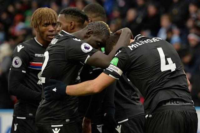 Huddersfield 0 Crystal Palace 2: Eagles secure huge win in the snow but injured Wilfried Zaha forced off