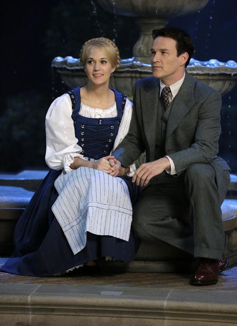 """This image released by NBC shows Carrie Underwood, left, as Maria, and Stephen Moyer as Captain Von Trapp during preparations for """"The Sound of Music Live!, in Bethpage, N.Y. The live production airs on Dec. 5 at 8 p.m. EST. (AP Photo/NBC, Paul Drinkwater)"""