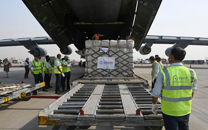 Relief supplies from the United States arrive at the Indira Gandhi International airport - Prakash Singh
