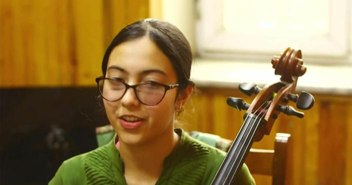 Image: Meena Karimi, a 16-year-old student at the Afghanistan National Institute of Music in Kabul.