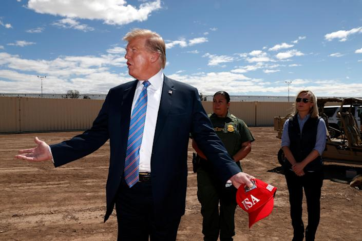 President Trump visits a new section of the border wall with Mexico in Calexico, Calif., on Friday. (AP Photo/Jacquelyn Martin)