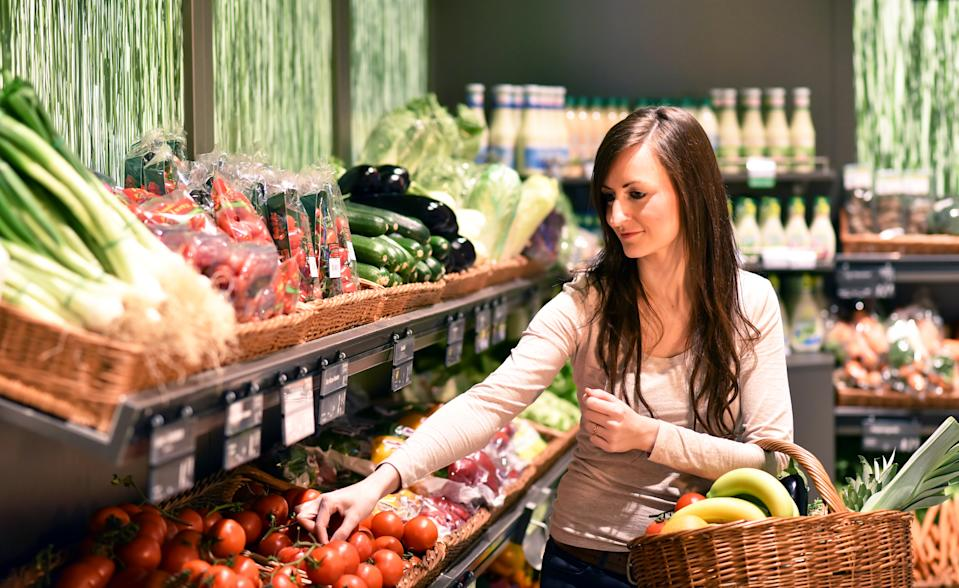 young pretty woman shopping for fresh healthy food in the supermarket