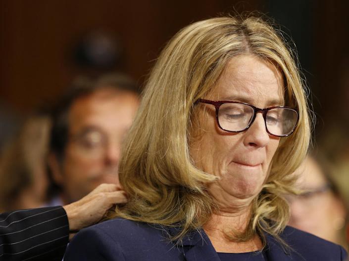 Christine Blasey Ford reacts as she speaks before the Senate Judiciary Committee. (Photo: Michael Reynolds/pool via Reuters)