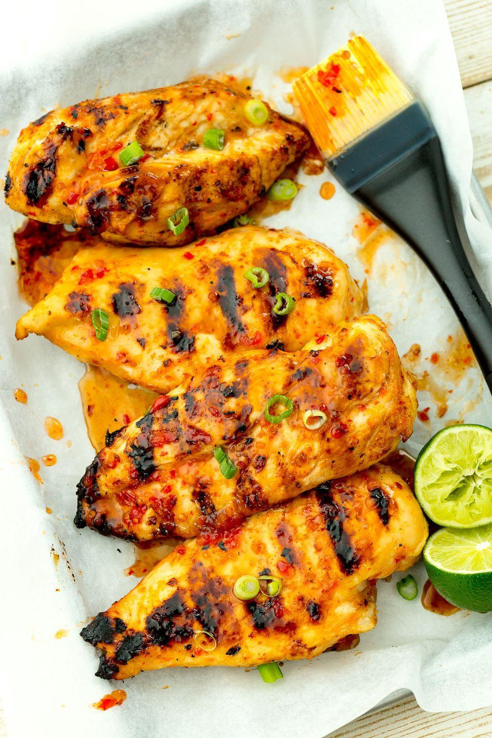 """<p>Grilled chicken gets a punch of flavor from sticky sweet-chili sauce.</p><p>Get the recipe from <a href=""""https://www.delish.com/cooking/recipe-ideas/recipes/a47356/sweet-chili-lime-grilled-chicken-recipe/"""" rel=""""nofollow noopener"""" target=""""_blank"""" data-ylk=""""slk:Delish"""" class=""""link rapid-noclick-resp"""">Delish</a>.</p><p><a class=""""link rapid-noclick-resp"""" href=""""https://www.amazon.com/Pyrex-Prepware-3-Piece-Glass-Mixing/dp/B00LGLHUA0/?tag=syn-yahoo-20&ascsubtag=%5Bartid%7C1782.g.2180%5Bsrc%7Cyahoo-us"""" rel=""""nofollow noopener"""" target=""""_blank"""" data-ylk=""""slk:BUY NOW"""">BUY NOW</a> <strong><em>Pyrex Bowls, $10, amazon.com.</em></strong></p>"""
