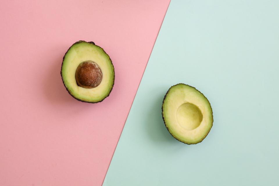 Avocado on pink and green background
