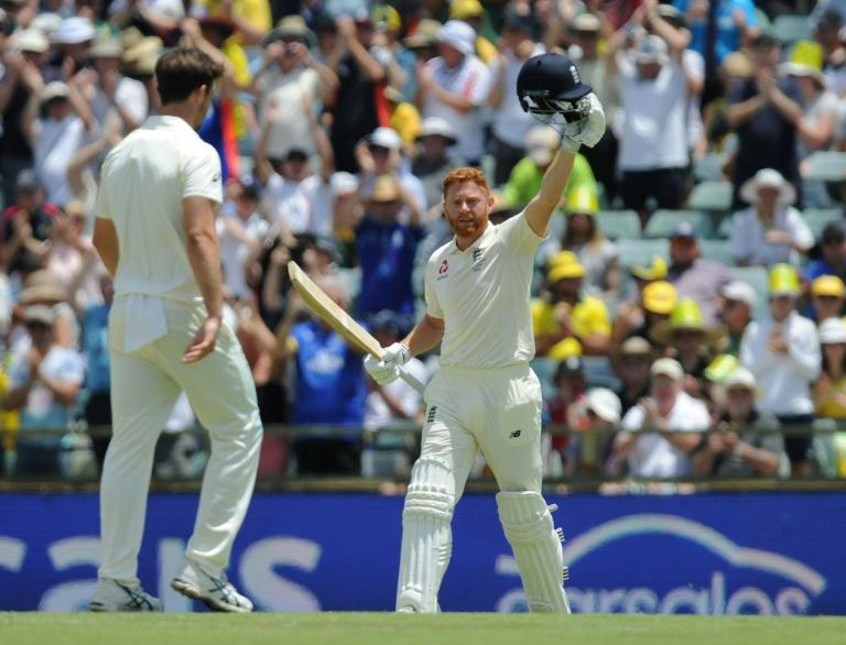 England's Jonny Bairstow celebrates reaching his century on day two of the third Ashes Test match against Australia in Perth on December 15, 2017