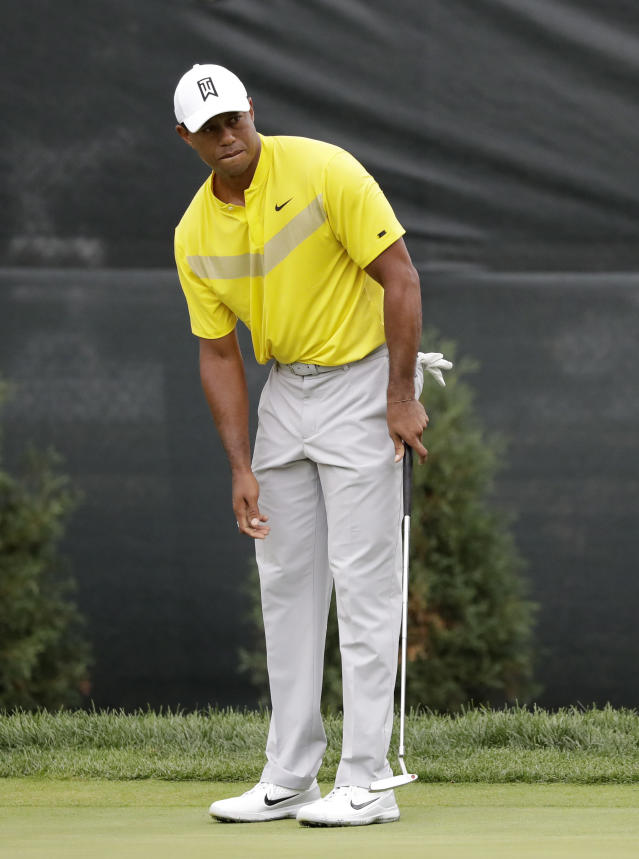 Tiger Woods watches his put on the 10th hole during the third round of the BMW Championship golf tournament at Medinah Country Club, Saturday, Aug. 17, 2019, in Medinah, Ill. (AP Photo/Nam Y. Huh)