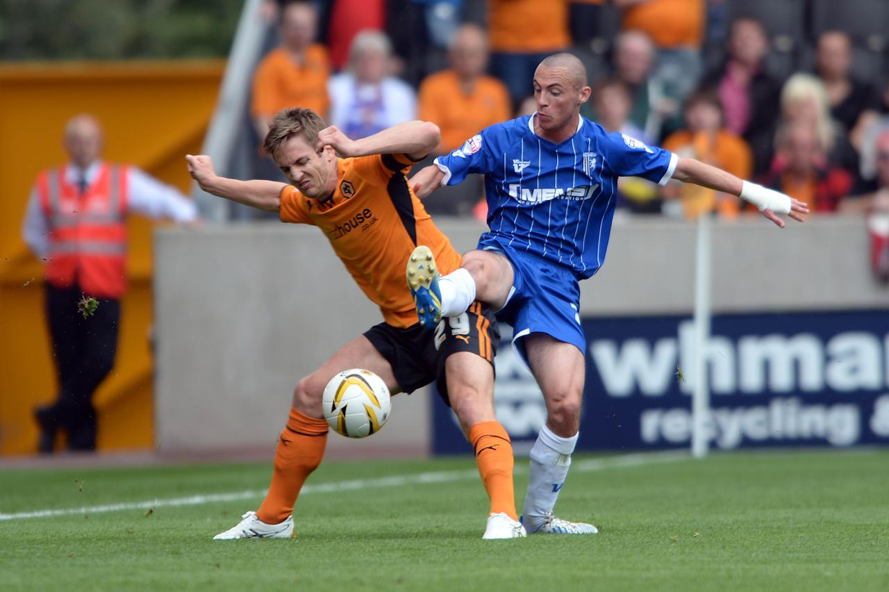 Wolves' Kevin Doyle and Gillingham's Michael Harriman battle for the ball during the Sky Bet League One match at the Molineaux, Wolverhampton.