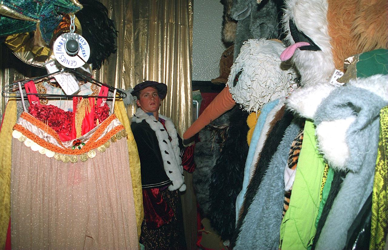21 DEC 1994: ENGLAND CRICKETERS  TRY THEIR FANCY DRESS OUTFITS ON FOR THE CHRISTMAS DINNER, DARREN GOUGH DRESSING AS A KING BUT LOOKING AROUND FOR ANOTHER OUTFIT. Mandatory Credit: Ben Radford/ALLSPORT