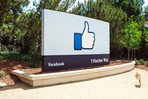 The Facebook sign in front of its headquarters shows its signature like button.