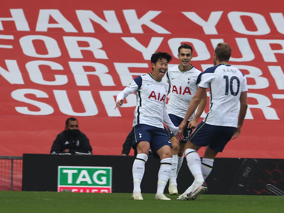 MANCHESTER, ENGLAND - OCTOBER 04: Heung-Min Son of Tottenham Hotspur celebrates scoring their second goal during the Premier League match between Manchester United and Tottenham Hotspur at Old Trafford on October 04, 2020 in Manchester, England. Sporting stadiums around the UK remain under strict restrictions due to the Coronavirus Pandemic as Government social distancing laws prohibit fans inside venues resulting in games being played behind closed doors. (Photo by Matthew Peters/Manchester United via Getty Images)