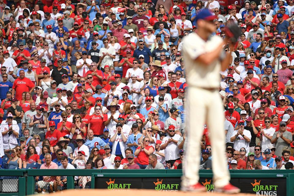 Fans at Citizens Bank Park cheer during the ninth inning of Zack Wheeler's complete game shutout against the Mets.