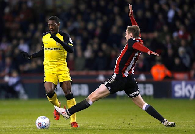 "Soccer Football - Championship - Sheffield United vs Burton Albion - Bramall Lane, Sheffield, Britain - March 13, 2018 Burton Albion's Marvin Sordell in action with Sheffield United's James Wilson Action Images/Ed Sykes EDITORIAL USE ONLY. No use with unauthorized audio, video, data, fixture lists, club/league logos or ""live"" services. Online in-match use limited to 75 images, no video emulation. No use in betting, games or single club/league/player publications. Please contact your account representative for further details."