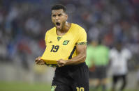 Jamaica defender Adrian Mariappa (19) reacts after they Jamaica defeated Haiti 1-0 in a CONCACAF Gold Cup soccer quarterfinal Saturday, July 18, 2015, in Baltimore. (AP Photo/Nick Wass)