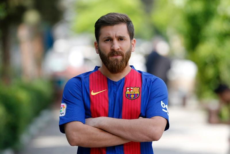 Reza Parastesh has become a sensation in Iran for his resemblance to Barcelona and Argentina striker Lionel Messi (AFP Photo/ATTA KENARE)