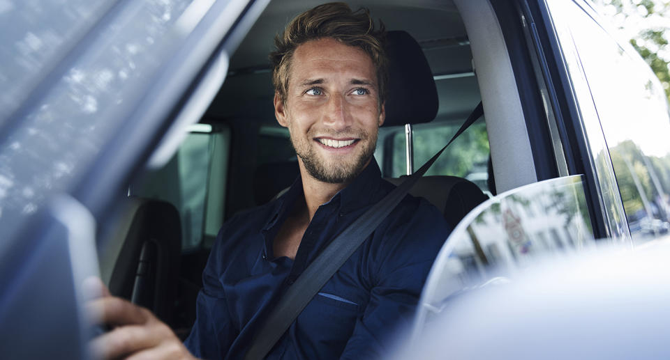 A man smiles in a car. Source: Getty Images