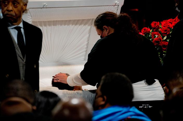 Katie Wright caresses the head of her son Daunte Wright, who was was shot and killed by police in nearby Brooklyn Center. The memorial viewing of his body was held the day after a jury convicted former Minneapolis police Officer Derek Chauvin in the murder of George Floyd.