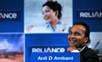 Indian industrialist and Chairman of ADAG (Anil Dhirubhai Ambani Group) Anil Ambani smiles during the annual general meeting of Reliance Power in Mumbai on September 4, 2012. Reliance Power, controlled by billionaire Anil Ambani, said that it started production at two coal mines in central India, ahead of schedule, which sent its shares up two percent. Coal from the Sasan mines will be used to generate electricity at the firm's 3,960-megawatt power project in the same region, a company statement said. AFP PHOTO/ INDRANIL MUKHERJEE