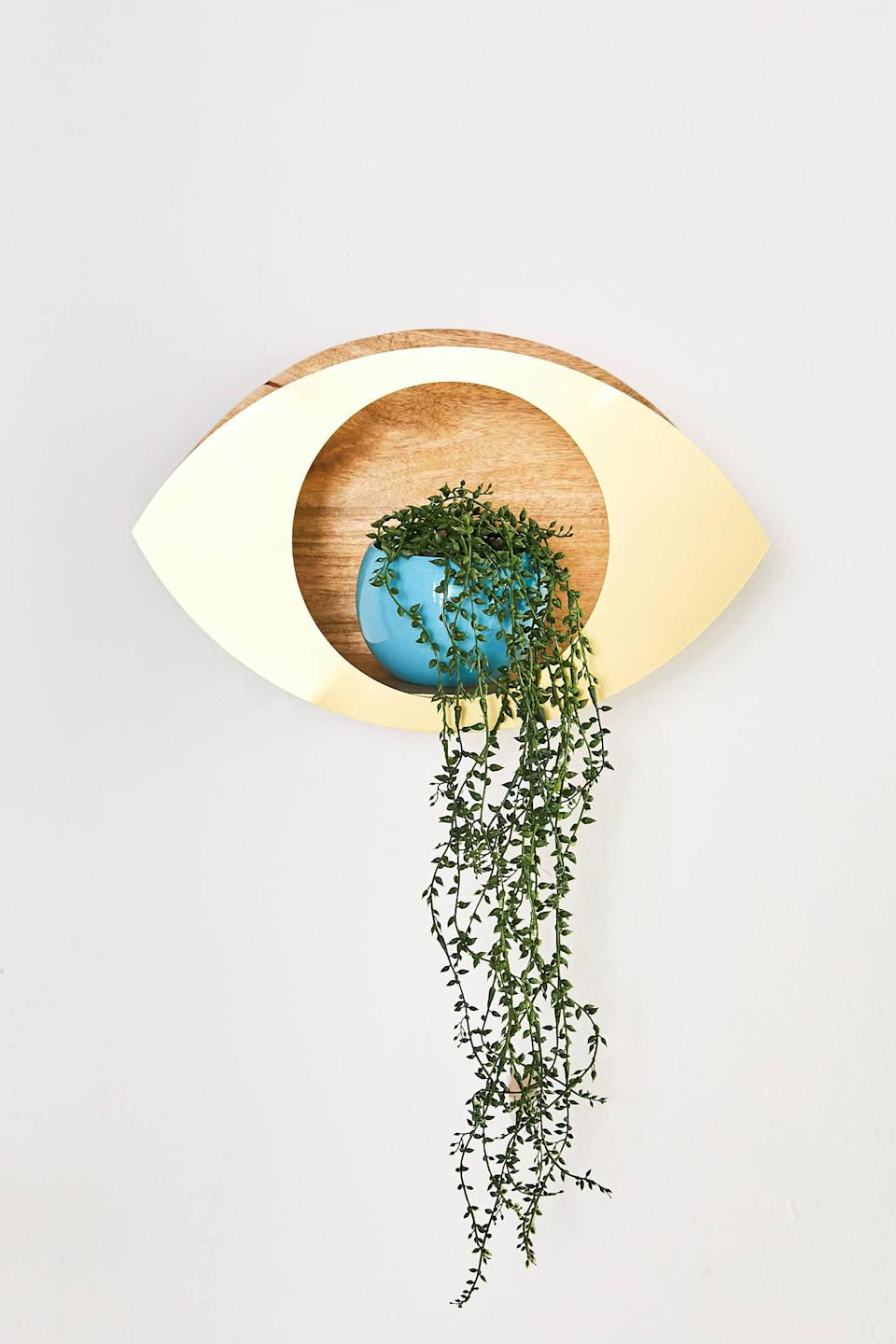 "<br> <br> <strong>Urban Outfitters</strong> Eye Plant Wall Shelf, $, available at <a href=""https://go.skimresources.com/?id=30283X879131&url=https%3A%2F%2Fwww.urbanoutfitters.com%2Fshop%2Feye-plant-wall-shelf"" rel=""nofollow noopener"" target=""_blank"" data-ylk=""slk:Urban Outfitters"" class=""link rapid-noclick-resp"">Urban Outfitters</a>"