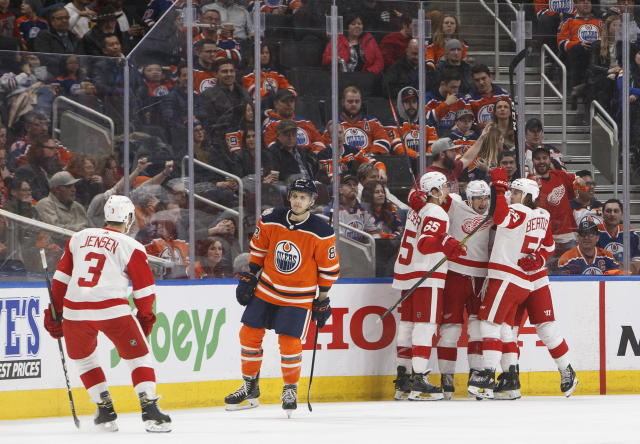 Detroit Red Wings celebrate a goal as Edmonton Oilers' Matthew Benning (83) skates past during second period NHL action in Edmonton on Tuesday, Jan. 22, 2019. (Jason Franson/The Canadian Press via AP)