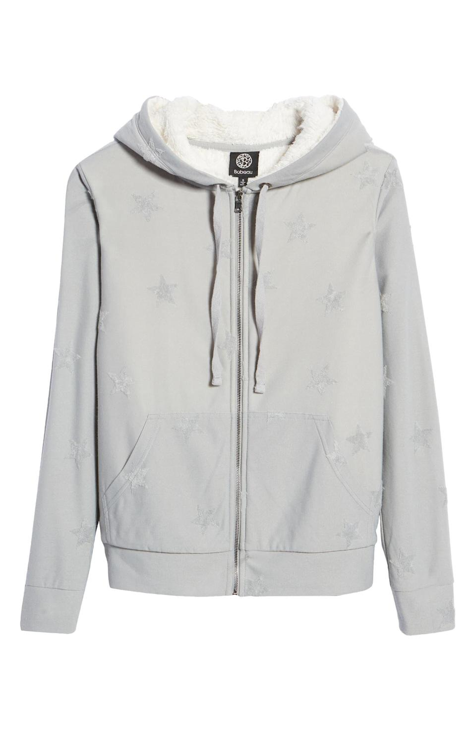 """<p>Feeling cold is completely out of the question with Bobeau's Flocked Zip Hoodie. A thick, plush fleece lining will ensure that no cool breezes hit your body. And what's even better is that the zip front makes it easy to take on and off if you get too toasty. It comes in four colors that each has an embroidered pattern like the subtle stars on this gray one. </p> <p><strong>Sizes available:</strong> XS to XL</p> <p><strong>$59</strong> (<a href=""""https://click.linksynergy.com/deeplink?id=MZ9491VLjxM&mid=1237&u1=AllureCozyLoungewear&murl=https%3A%2F%2Fwww.nordstrom.com%2Fs%2Fbobeau-flocked-zip-hoodie%2F5740941%3F"""" rel=""""nofollow noopener"""" target=""""_blank"""" data-ylk=""""slk:Shop Now"""" class=""""link rapid-noclick-resp"""">Shop Now</a>)</p>"""