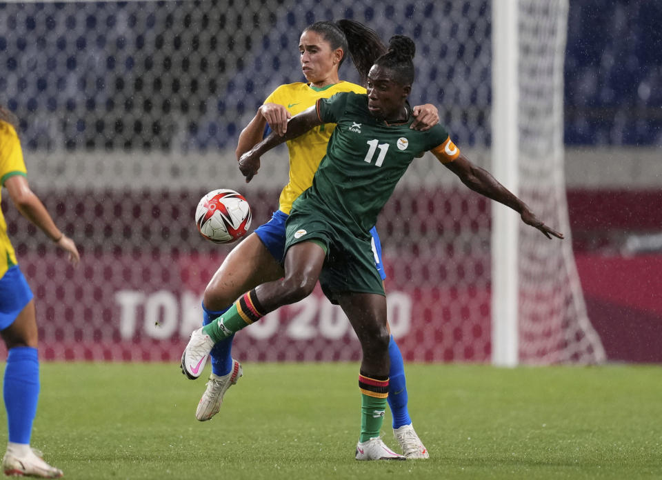 Brazil's Angelina, back, and Zambia's Babra Banda battle for the ball during a women's soccer match at the 2020 Summer Olympics, Tuesday, July 27, 2021, in Saitama, Japan. (AP Photo/Martin Mejia)