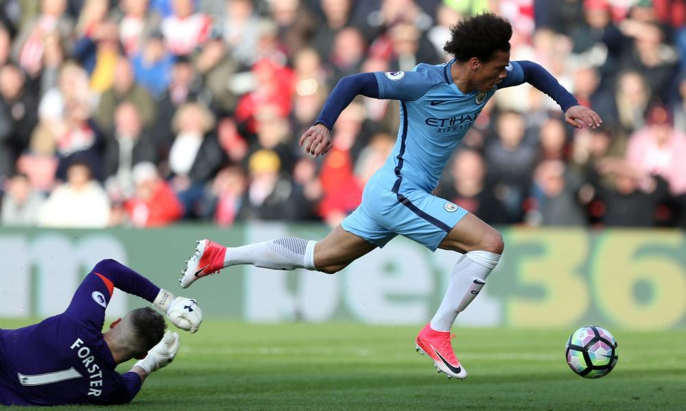 Manchester City's Leroy Sané goes down under a challenge from Fraser Forster.
