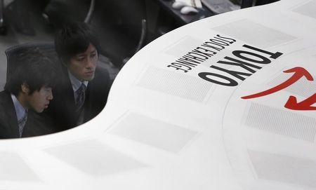 Tokyo Stock Exchange (TSE) staff members work at the bourse at TSE in Tokyo