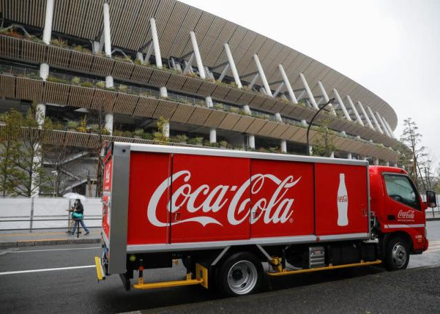 A delivery van of a Worldwide Olympic Partners' Coca-Cola beverages is parked in front of National Stadium, the main stadium of Tokyo 2020 Olympics and Paralympics, in Tokyo