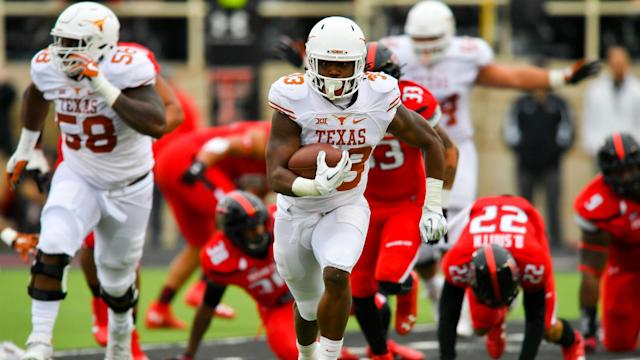 Foreman used his son's death as an inspiration in a remarkable season for the Longhorns in which he rushed for 2,028 yards and 15 TDs.