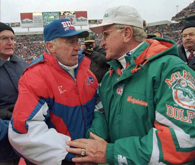 FILE - In this Dec. 30, 1995, file photo, Buffalo Bills head coach Marv Levy, left and Miami Dolphins head coach Don Shula speak at midfield after the Bills beat the Dolphins in Shula's final game as head coach, at Rich Stadium in Orchard Park, N.Y. Shula, who won the most games of any NFL coach and led the Miami Dolphins to the only perfect season in league history, died Monday, May 4, 2020, at his home in Indian Creek, Fla., the team said. He was 90.(AP Photo/Bill Sikes, File)