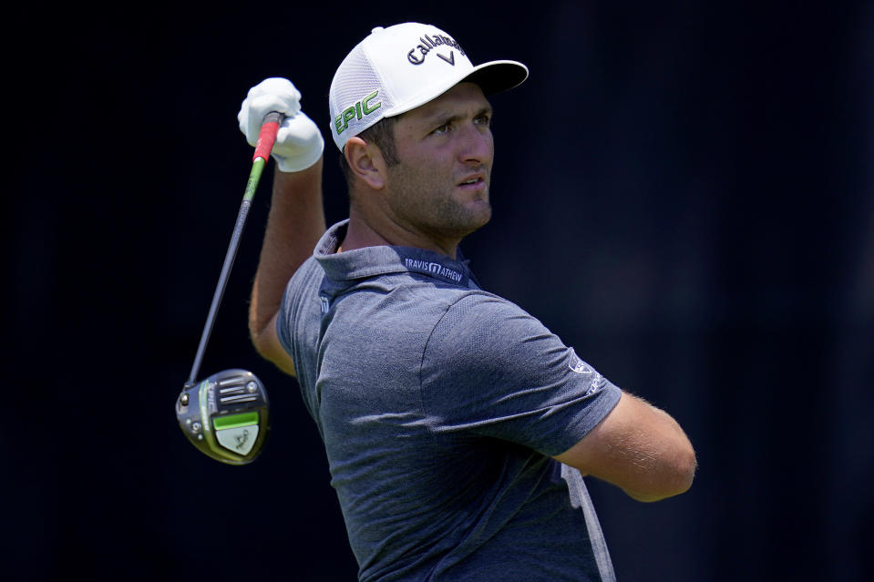 Jon Rahm, of Spain, hits from the seventh tee during a practice round of the U.S. Open Golf Championship, Tuesday, June 15, 2021, at Torrey Pines Golf Course in San Diego. (AP Photo/Gregory Bull)