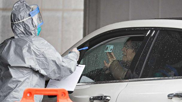 PHOTO: A driver arrives to be tested for the coronavirus at Glen Island Park in New Rochelle, New York on March 13, 2020. (John Minchillo/AP)