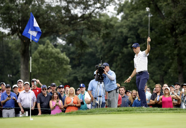 Justin Thomas celebrates as he makes a birdie on the 14th hole during the third round of the BMW Championship golf tournament at Medinah Country Club, Saturday, Aug. 17, 2019, in Medinah, Ill. (AP Photo/Nam Y. Huh)