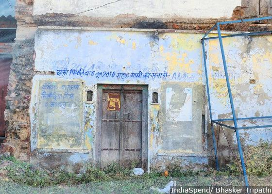 A dilapidated building reads a message to farmers of Budha village in Mandsaur district of MP.