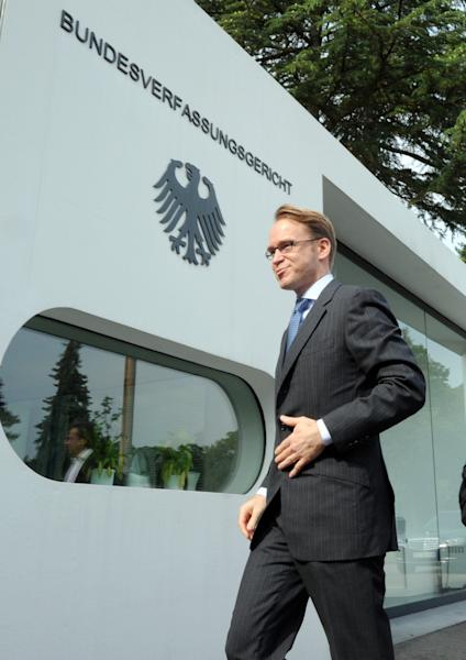 President of the German Federal Bank, Jens Weidmann, enters the German Constitutional Court in Karlsruhe, Germany, Wednesday June 12, 2013. A top European Central Bank official has defended the bank's key crisis backstop in a second day of hearings before Germany's Federal Constitutional Court. Joerg Asmussen told the eight judges that the ECB's plan to purchase government bonds was only aimed at making sure the bank's monetary policy is effective, not at rescuing governments in the 17-country eurozone. The ECB is prohibited by treaty from financing governments. But Asmussen insisted Wednesday that the ECB had not exceeded its powers with the bond purchases program, even to spare a country from going bankrupt. ( AP Photo/dpa,Uli Deck)