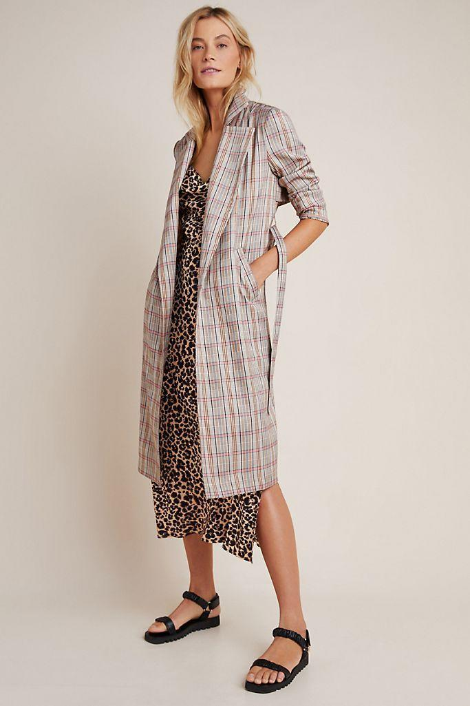 """<p><strong>Harlyn Anthropologie</strong></p><p>anthropologie.com</p><p><strong>$138.00</strong></p><p><a href=""""https://go.redirectingat.com?id=74968X1596630&url=https%3A%2F%2Fwww.anthropologie.com%2Fshop%2Fmarilyn-plaid-trench-coat&sref=https%3A%2F%2Fwww.goodhousekeeping.com%2Fbeauty%2Ffashion%2Fg32585880%2Frainy-day-outfits%2F"""" rel=""""nofollow noopener"""" target=""""_blank"""" data-ylk=""""slk:Shop Now"""" class=""""link rapid-noclick-resp"""">Shop Now</a></p><p>A classic print looks new again on this plaid, belted trench coat. It adds just the right amount of a menswear feel, but with a feminine touch. Slip on a leopard print dress for a contrasting mix up of prints.</p>"""