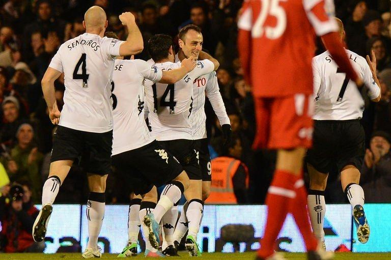 Fulham forward Dimitar Berbatov (C) celebrates his second goal during their Premier League match against Queens Park Rangers in London on April 1, 2013. QPR spurned another chance to improve their chances of survival in the Premier League after a gripping 3-2 loss at Fulham