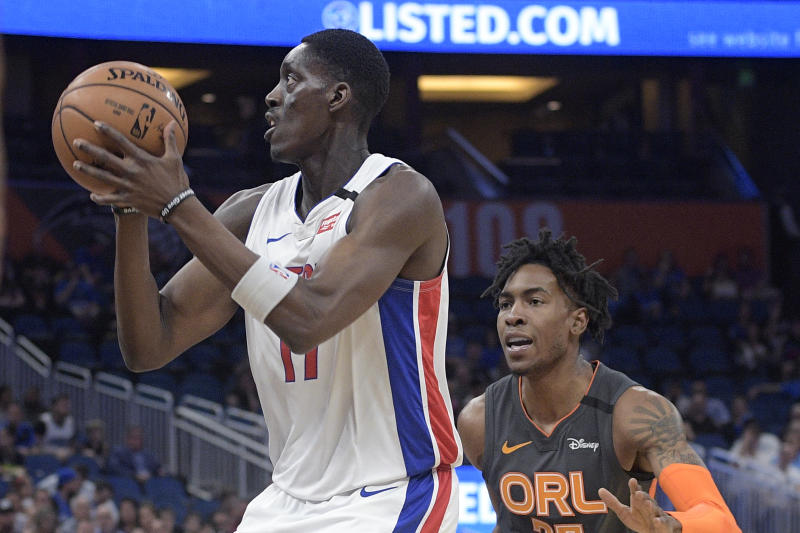 Detroit Pistons forward Tony Snell (17) drives to the basket in front of Orlando Magic forward Wes Iwundu, right, during the first half of an NBA basketball game Wednesday, Feb. 12, 2020 in Orlando, Fla. (AP Photo/Phelan M. Ebenhack)