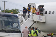 Haitians who were deported from the United States deplane at the Toussaint Louverture International Airport, in Port au Prince, Haiti, Sunday, Sep. 19, 2021. Thousands of Haitian migrants have been arriving to Del Rio, Texas, to ask for asylum in the U.S., as authorities begin to deported them to back to Haiti which is in a worse shape than when they left. (AP Photo/Joseph Odelyn)