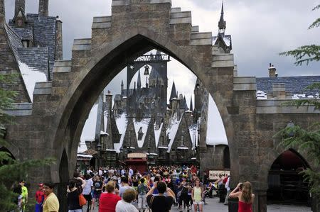 Guests walk in and out of Hogsmeade Village during a media preview for The Wizarding World of Harry Potter-Diagon Alley at the Universal Orlando Resort in Orlando